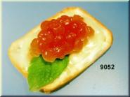 cracker with caviar yellow