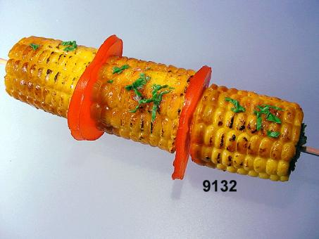 baby corn on a spit